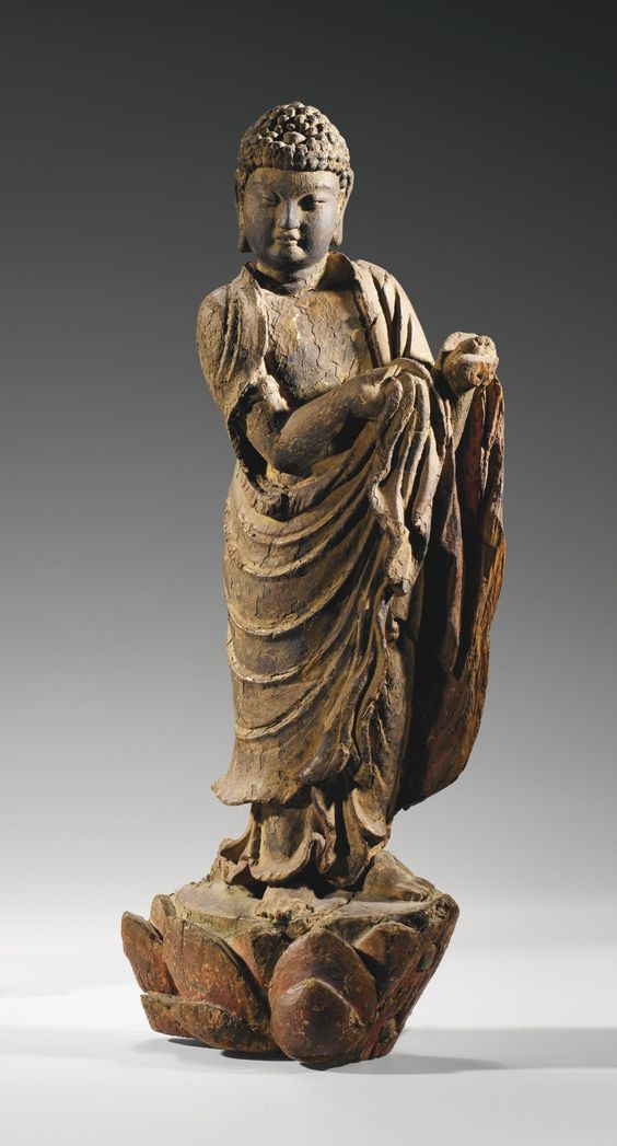 A RARE WOOD FIGURE OF BUDDHA, EARLY MING DYNASTY.: