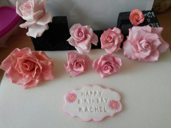 Sugar roses and plaque made by shirlie w