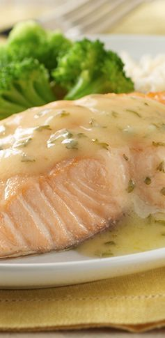Salmon baked from frozen for convenience and served with a simple lemon sauce