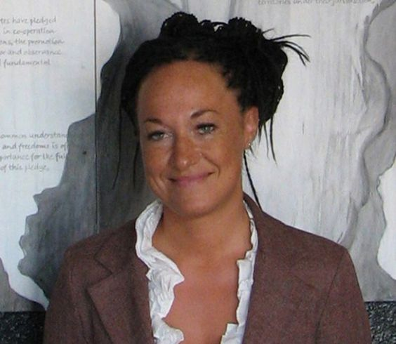 Rachel Dolezal on being a black woman   In this photo taken July 24, 2009, Rachel Dolezal, a leader of the Human Rights Education Institute, stands in front of a mural she painted at the institute's offices in coeur d'alene, idaho.