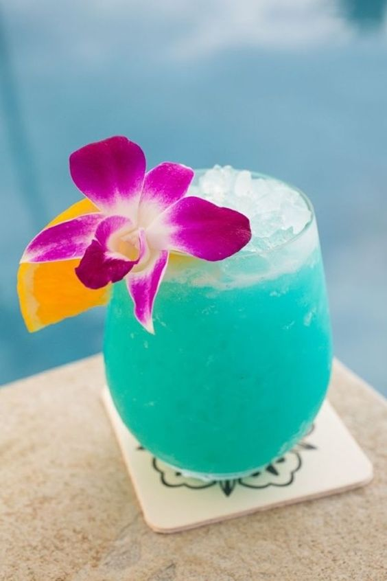 Ingredients: 4 cups ice 1 cup chilled pineapple juice 1/2 cup blue curacao 1/2 cup rum 1/2 cup cream of coconut 4 pineapple slices 4 maraschino cherries  Directions: Place the ice, pineapple juice, blue curacao, rum and cream of coconut into a blender and puree until smooth. Divide evenly among 4 glasses and garnish each with a pineapple slice and a cherry.