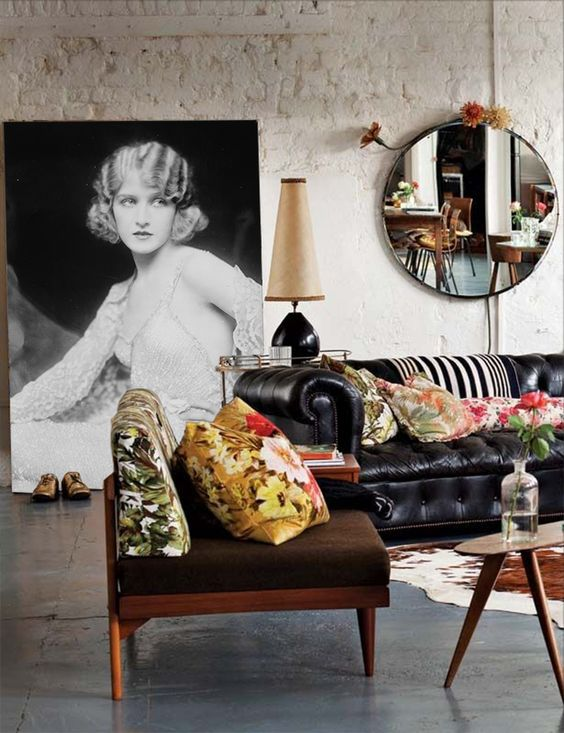 There are few design elements I hate more than floral prints, but the combination of the sumptuous leather couch of blown up image of a classic actress is striking. Color should be added, yes, but no floral.: