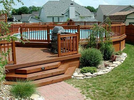 Landscaping around the deck with low bushes if i someday for Low maintenance pool landscaping