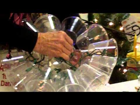 DIY- how to make a holiday light sparkle ball from clear plastic cups and a light set.   This version uses a drill and staples, instead of a soldiering iron
