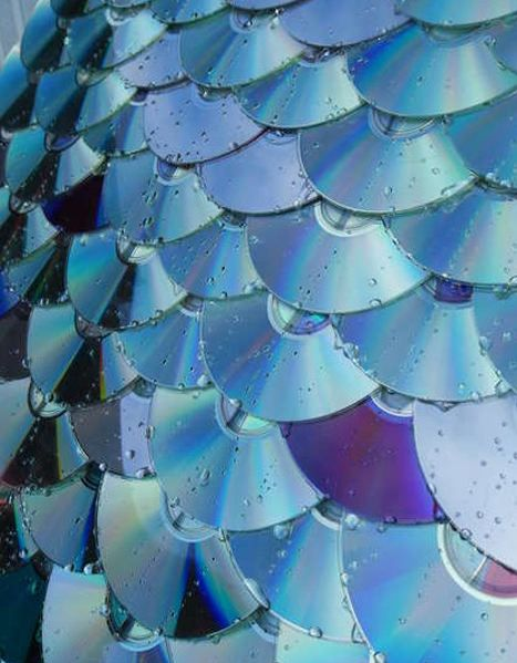 Great use of CDs and much prettier than some other roofing materials :-)