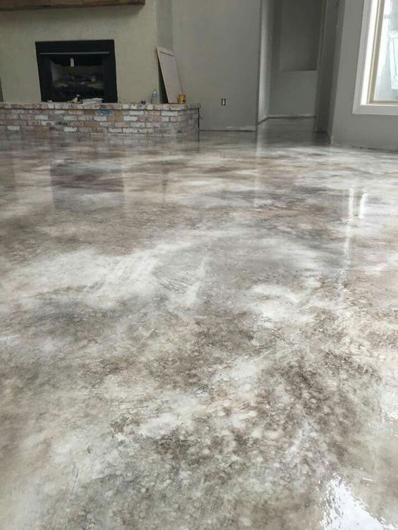 This basement has the traditional cement floors but they've been acid washed to give a slightly different look. It makes the floors shiny but also a little more tie-dye in appearance.