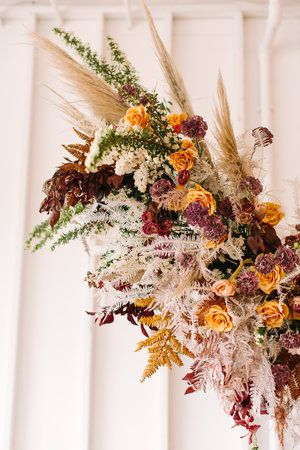 Hanging floral arrangement in fall color palette. Nashville floral designer, Rosemary & Finch.