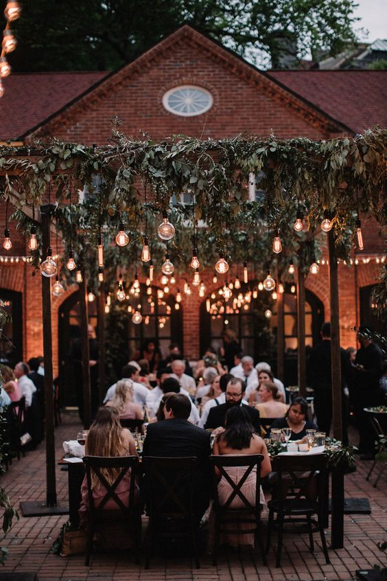 Greenery and edison light bulbs make for a romantic al fresco dinner party! photo by brightwood photography.