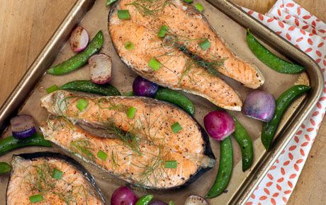 This delicious sheet-pan dinner is packed with fresh flavor and can be on the table in about 30 minutes. We suggest using salmon steaks, but you can substitute four 6-ounce salmon fillets.