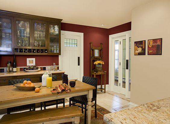 Rich Red Walls Create An Elegant Yet Cozy Kitchen