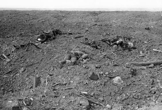"""Bodies of allied soldiers strewn about a bombed landscape in """"No Man's Land"""" in front of the Canadian lines at Courcelette in 1916, during t..."""