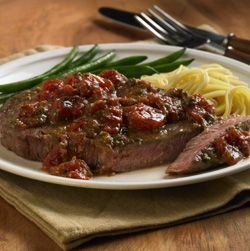 Rib Eye Steak Italiano,,, This Rib-eye steak recipe bursts with flavor when topped with fire roasted tomatoes in basil pesto