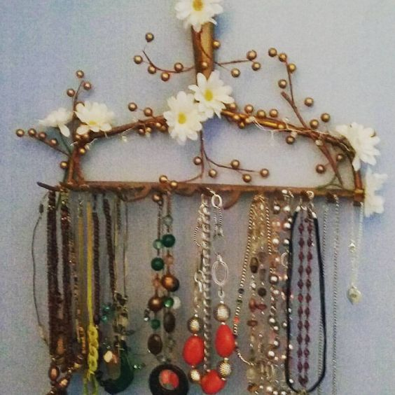 DIY Jewelry Holder ...made from an old garden rake, with a little paint and craft stuff total spent $1.97 for spray paint.