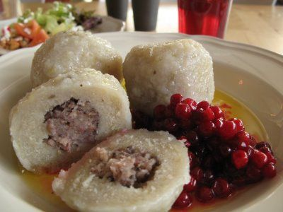 Swedish bak-zhang (meat dumpling), like a potato meatball accompanied with lingonberry.