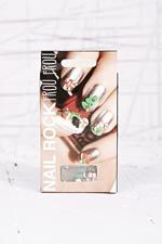 Nail Rock - Motifs de Noël pour ongles 9,00 € Urban Outfitters