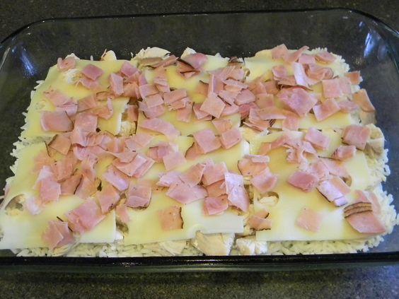 chicken cordon bleu casserole - rice, chicken, swiss cheese, ham, mix: cream of chicken soup, milk and sour cream, sprinkle on saltine crackers (with paprika, garlic salt, and parsley)