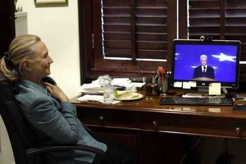 Secretary of State Hillary Clinton in East Timor, watching former President Bill Clinton delivering keynote at the Democratic National Convention.