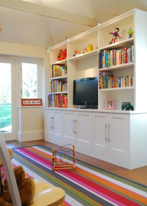 FAVORITE for basement toy storage. Even better if it isn't completely built in so that we could easily reuse/repupose it after future remodel.