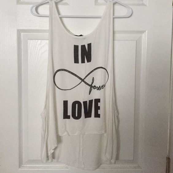 """""""In Forever Love"""" muscle tank Semi high low muscle tank. Off white color with black writing and rhinestones (none missing). There isn't a tag to show the size but it's a Large. I can measure of need be  Tops Muscle Tees"""