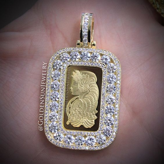 GOLDEN SUN JEWELRY: 10g. Suisse Gold bar in our Russian cut diamond frame. Dare to be different. @goldensunjewelry #goldensunjewelry #tags #pendant #stunning #suisse #diamondpendant #diamonds #detroit #fashionista #flawless #fashion #gia #goldbar #gold #haute #jewelry #kilogang #bullion #bespoke #bling #certified #currency #couture #luxury #lavish #l4p