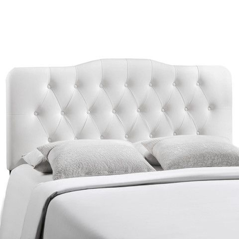 White leather headboard.  Master bedroom.