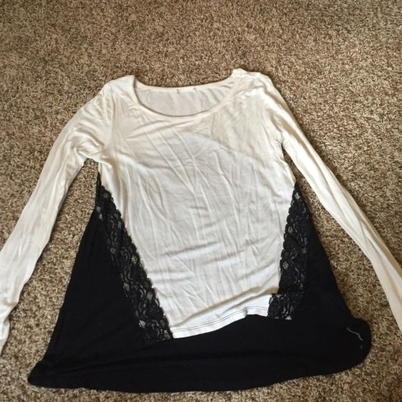 Lace black and white long sleeve top Perfect for a night out or at the office. Tag has been cute out but never worn! Tops