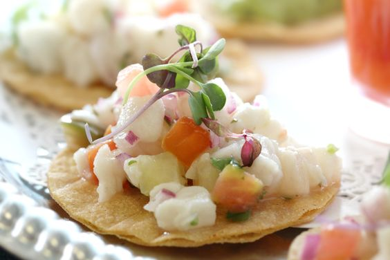 Warm summer days in Southern California call for something light, refreshing & satisfying like our Tostadita de Ceviche appetizer. Made with tangy red snapper morsels resting on a crisp tortilla, it's a cool way to get the appetite going. More info: https://www.sohotaco.com/2016/06/25/cool-refreshing-satisfying-tostadita-ceviche-on-a-warm-summer-day/ #tacocatering #ocfoodies #weddingidea #weddingideas