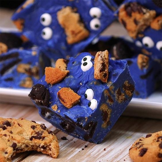 Cookie Monster Fudge. Melt blue chocolate candies. Add sweetened condensed milk. Stir in broken chocolate chip cookies. Pour into pan. Press more broken cookies into top and add candy eyes.