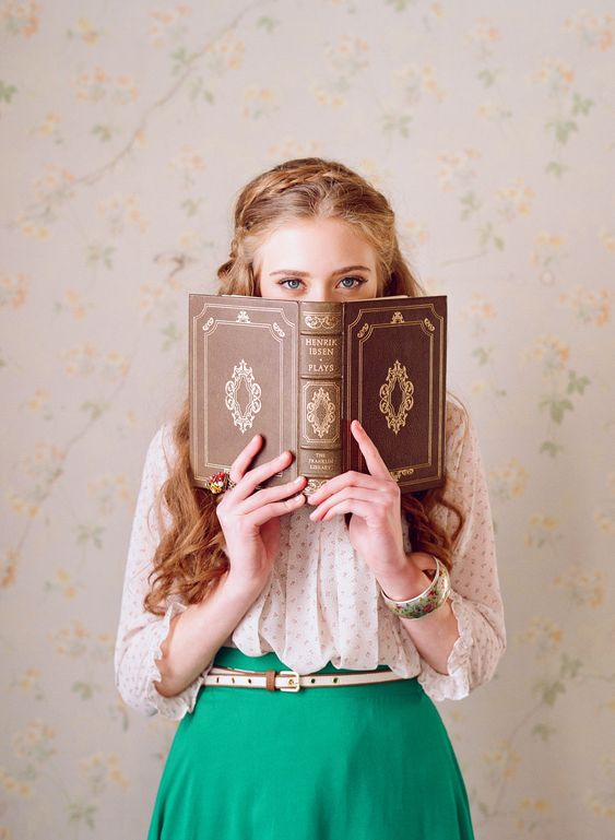 I love the idea of portraits behind books, pick a winner!  I think this would work well for a e-shoots too, with the couple holding up a book to obscure parts of their face: