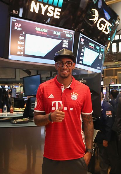 Jerome Boateng of FC Bayern Muenchen gives a thumb up after rang the New York Stock Exchange Opening Bell to highlight the upcoming International...