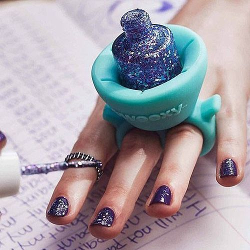 Give yourself a manicure the easy way with help from this wearable nail polish holder. This over sized silicone ring fits comfortably over your fingers and is designed to grip the bottle securely so you can move around freely without fear of spills. - gifts for her