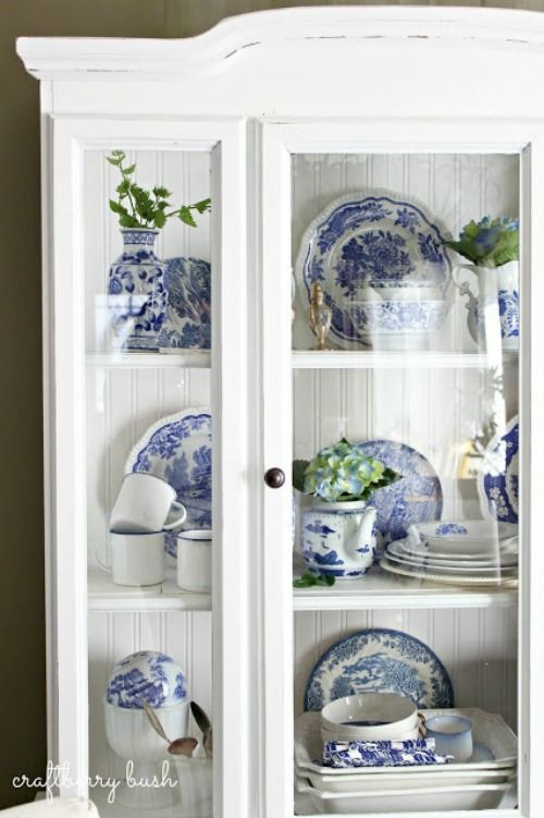 Blue And White Transferware China Dishes In White Hutch