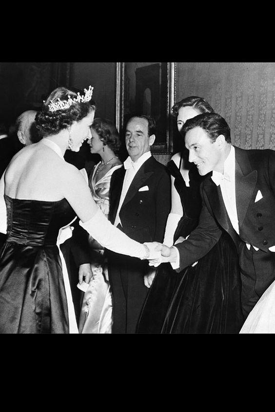 Master of the musical and Hollywood heart throb Gene Kelly looked debonair as he met her Majesty at a Royal Film Performance in 1957.