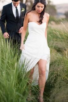 Ivory sexy slit summer informal wedding dress. Strapless bodice with sweetheart neckline, floor length skirt with slit front adds sexy elements.#custom wedding dress#custom made wedding dress#summer wedding dresses#