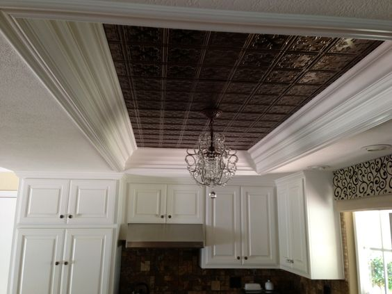 kitchen ceiling tiles and hanging light replace dated fluorescent lighting.
