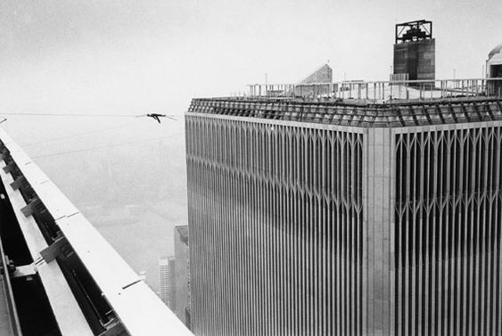 At one point in his walk, Petit lies down on the wire. All alone. Silently. At 1350 feet, he lies down suspended between the tallest building in the world. A plane flies overhead.