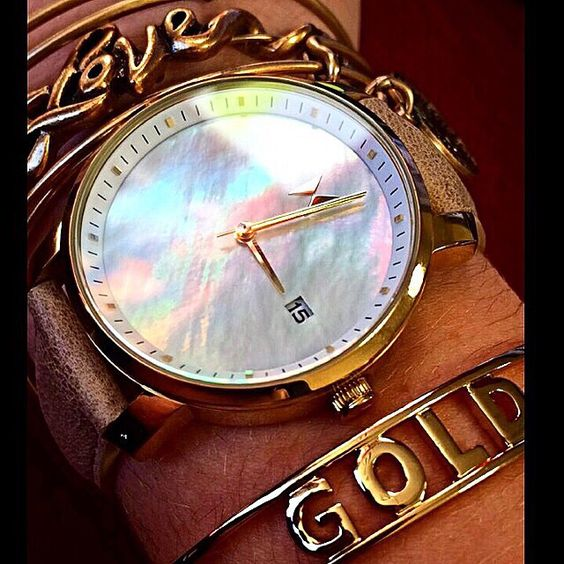 Women's fashion accessories. Gold pearl leather watch and gold bracelets!
