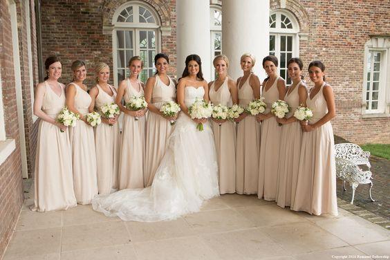Radebaugh/Betancourt Wedding - Remnant Fellowship Weddings  Champagne bridesmaids, long train, large bridal party