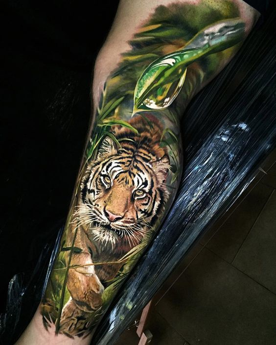 realistic tiger in the jungle best tattoo ideas