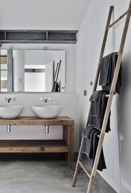 Beautiful timber creates a rustic look for this bathroom! Love timber ladders for hanging towels and magazines on!: