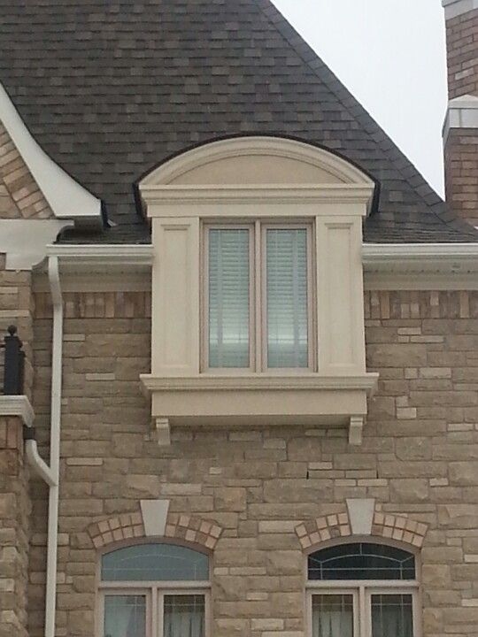 Simple yet elegant bay window/dormer design.