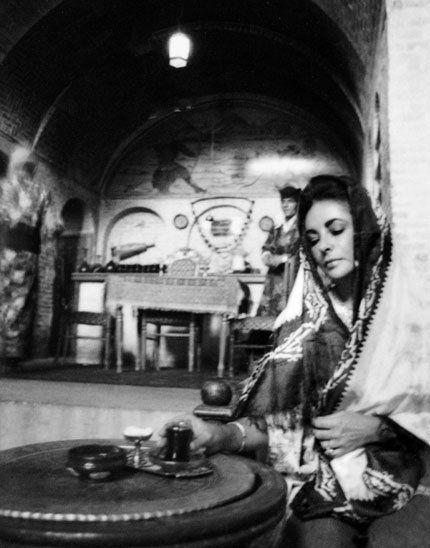 Elizabeth Taylor taking tea in Shiraz, Iran, 1976.