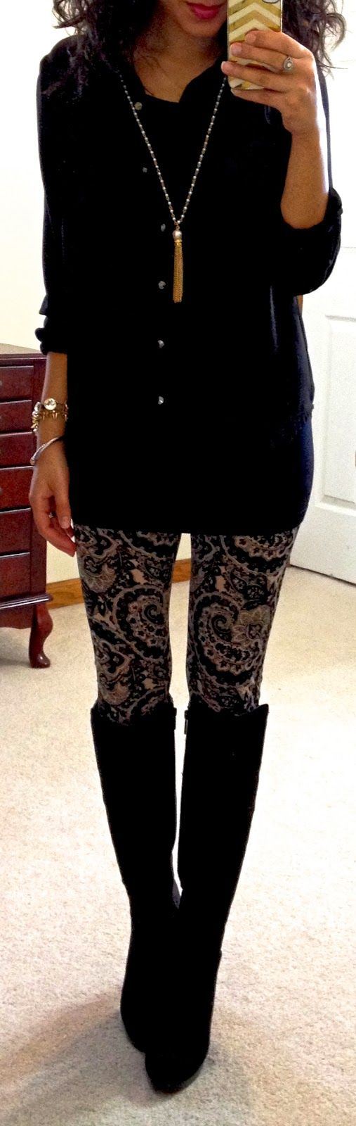 Long black blouse/black and gold leggings/high boots ...