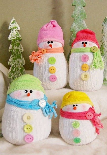 Squishy handmade snowmen made from socks and buttons! What a lovely DIY Christmas decoration
