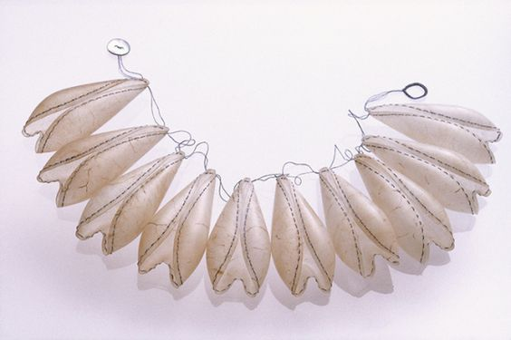 "Inni Pärnänen, ""Extra Organs"" neckpieces, 2003. Parchment, silk thread, mother of pearl. Reproduced from http://www.inni.fi/gallery:"