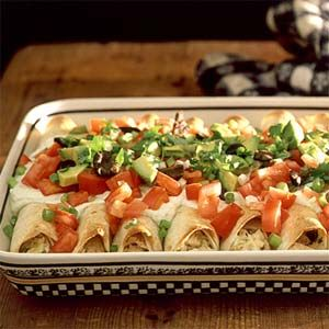These easy, cheesy chicken enchiladas come together in a snap...use fat free greek yogurt instead of sour cream for lower fat!