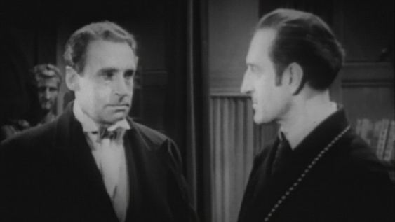 Henry Daniell as Professor Moriarty and Basil Rathbone as Holmes