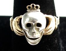18th Century Skull Ring.  Lovely hands clasp the skull whose lower jaw is on hinges so it moves! Marked W.w. Possibly for William Walsh Goldsmith English.