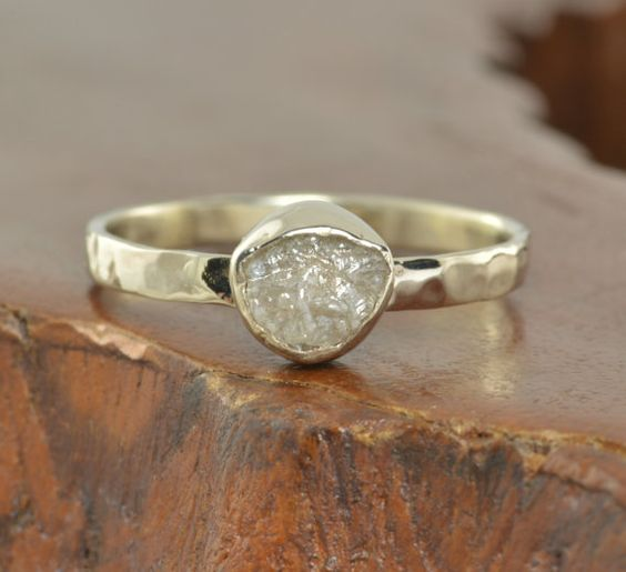 This ring features a beautiful 1 carat natural uncut conflict free diamond. The diamond has been set in a handmade 14k white gold bezel