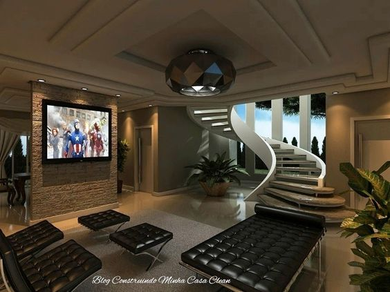 30 salas de estar decoradas com escadas em curva for Sala de estar grande com escada